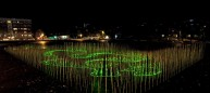 """By day, it is possible to """"read"""" the dynamic swooping forms, and at night the lasers transform the field into a mesmerizing play of light. There are 11 different programs that sequence over a 35 minute loop. Photo: Corey Scherrer"""