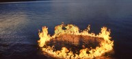"""15' d: water, propane flame: ©1991A site specific environmental sculpture of a 15 foot diameter ring with flames erupting up to 3 feet high."