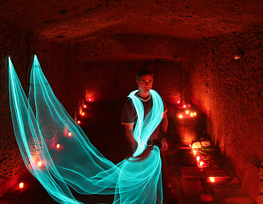 Etruscan cellar 3 stories under the tuffa. Timelapse experimentation with electroluminescent cable and funerary candles.