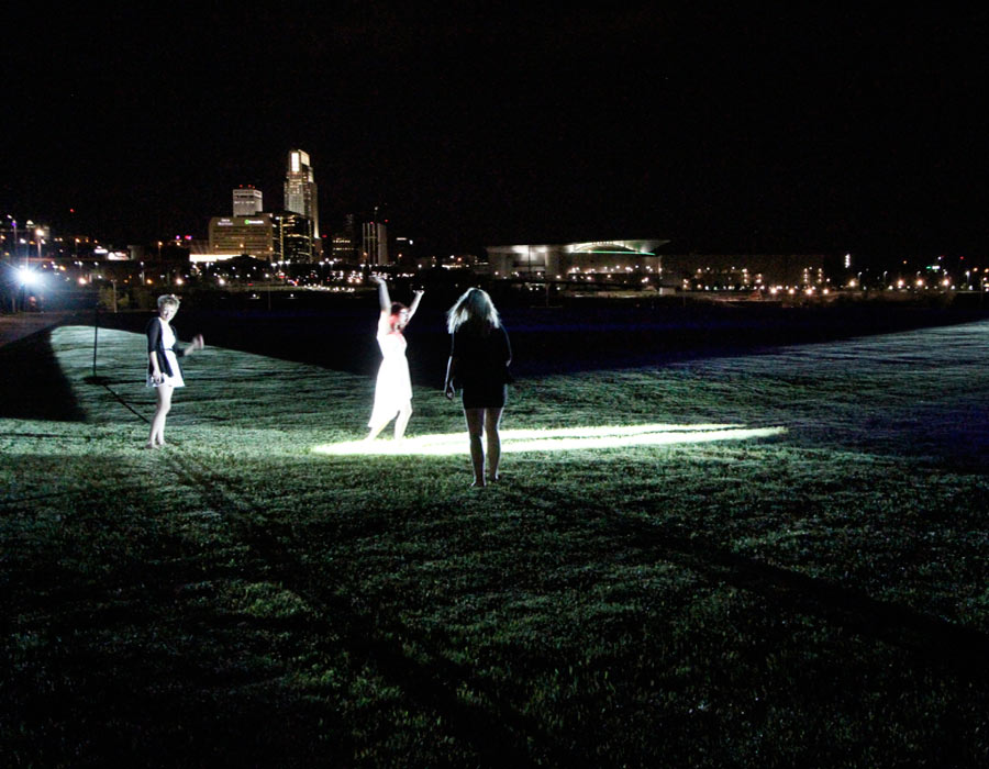 "Robotic Searchlights play ""Steal Dorothy Hamill's Spotlight"" with park users."