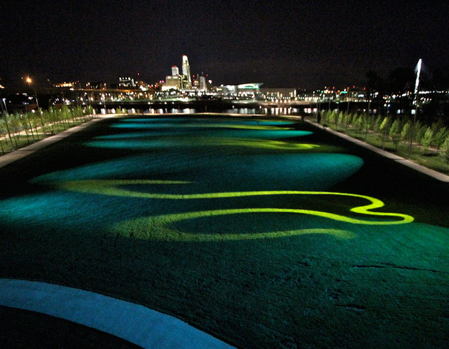 Riverfront Park, Council Bluffs Iowa, 2013. Lawn, robotic lighting fixtures, dynamic pattern projectors, Infra red camera, doplar radar sensors, custom interactive software and hardware